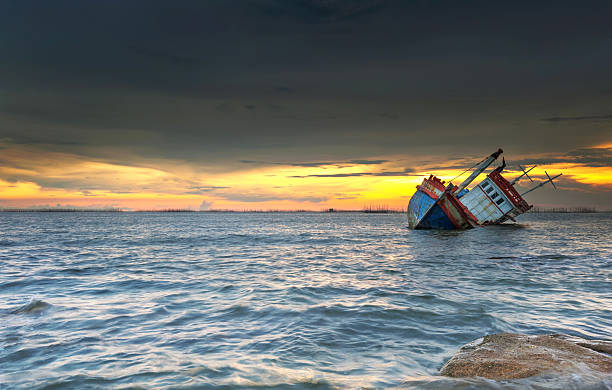 ship wrecked at sunset in chonburi ,thailand - shipwreck stock pictures, royalty-free photos & images