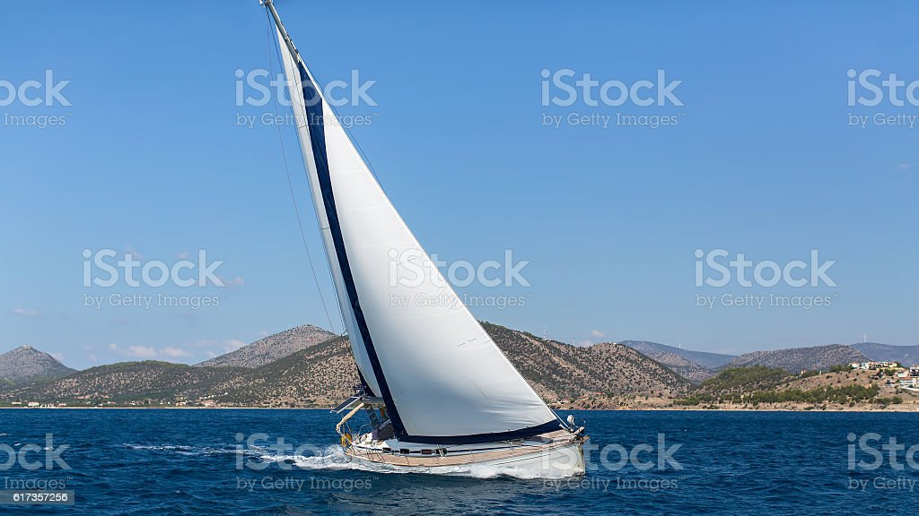 Ship Yachts With White Sails In The Open Sea Stock Photo & More