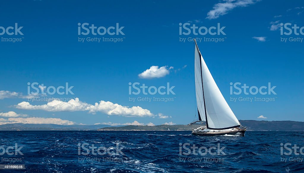 Ship yachts with white sails in the open Sea. Sailing stock photo