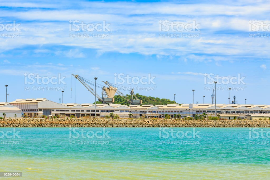 Ship yard and green sea in cloudy day in Thaialnd stock photo