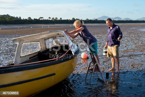 father and daughter bond painting a fixer upper of a boat