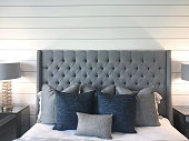 bed with shiplap wall