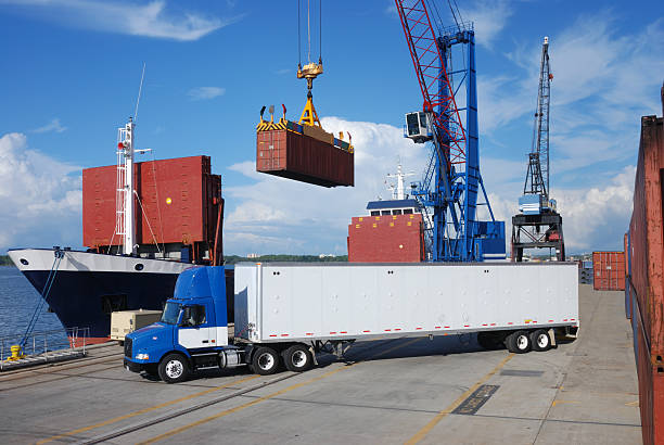 shipping and trucking transportation industry - lorries unloading stock photos and pictures