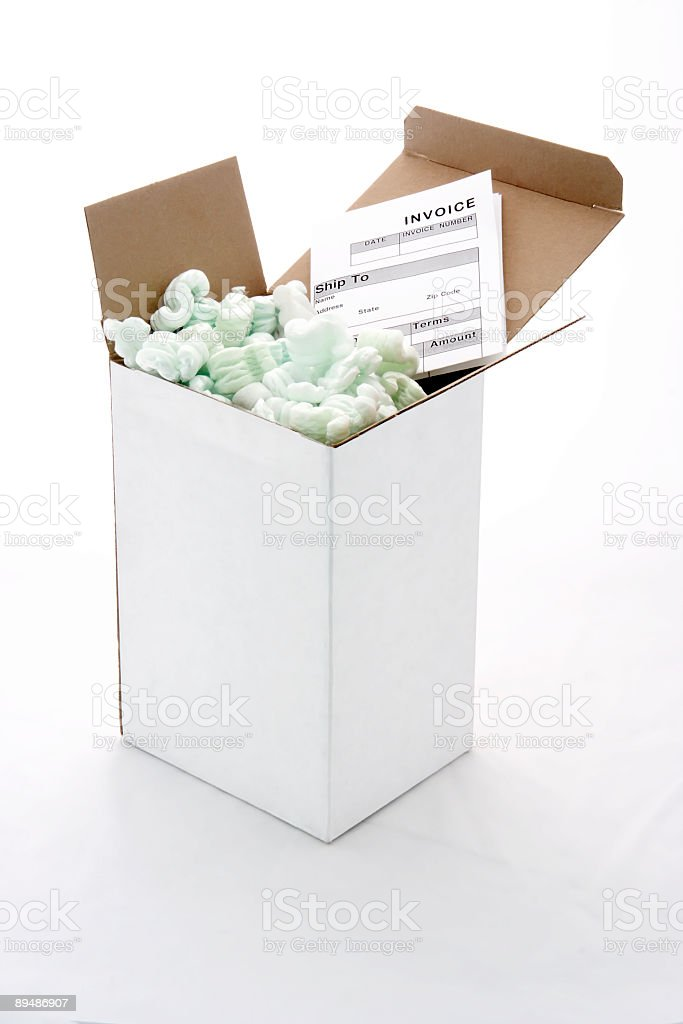 Shipping Box with Packaging Peanuts and Invoice royalty-free stock photo
