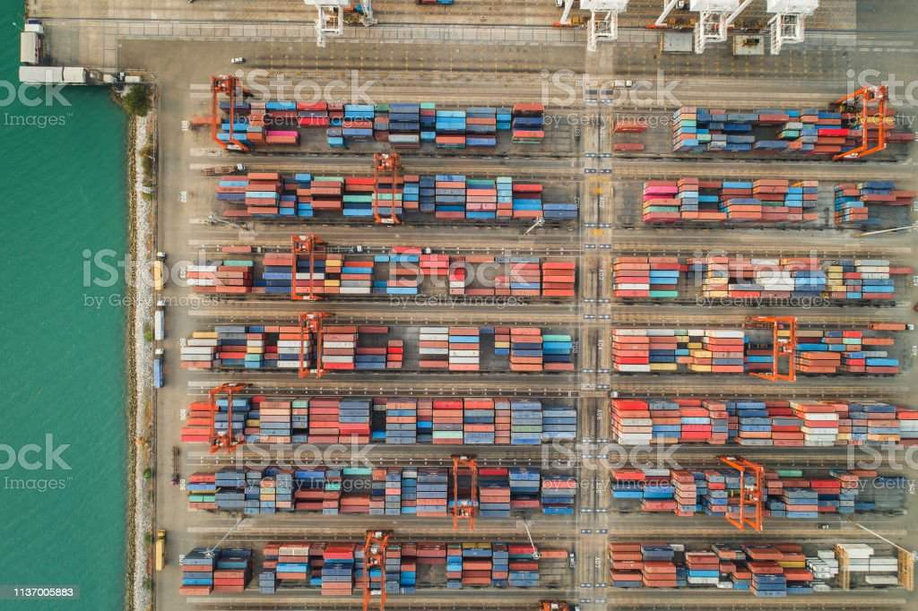 Aerial view container ship to sea port loading container for import...
