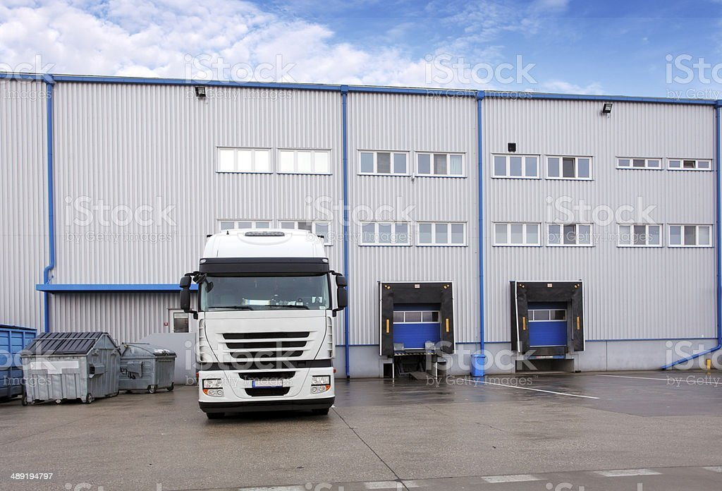 Shipping cargo truck at warehouse building stock photo