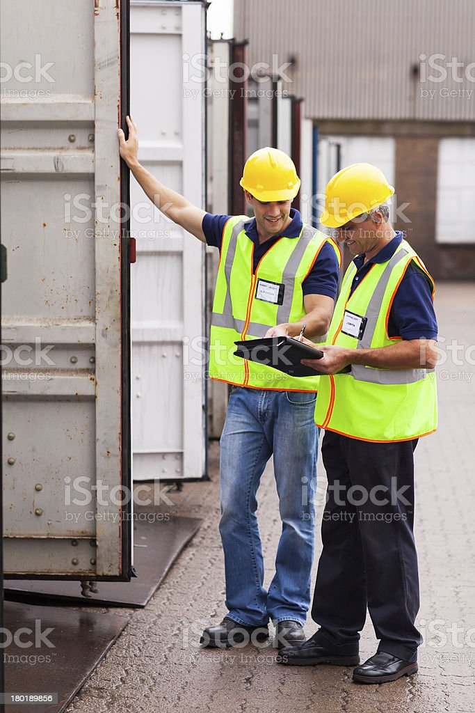 shipping company workers recording containers royalty-free stock photo