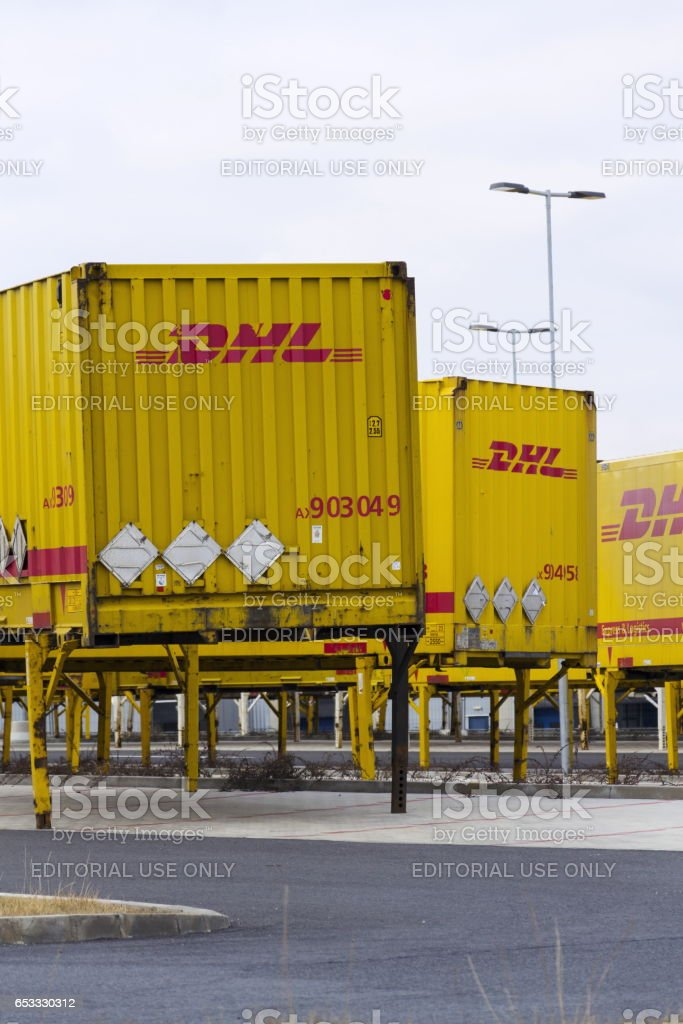 Dhl Shipping Containers In Front Of Amazon Logistics Building Stock
