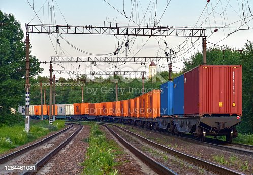 Shipping containers of ZIH Zhengzhou International Hub transportation on cargo train by railway. China-Europe freight trains. Object in motion, soft focus. JUNE 19, 2020 Russia, Moscow