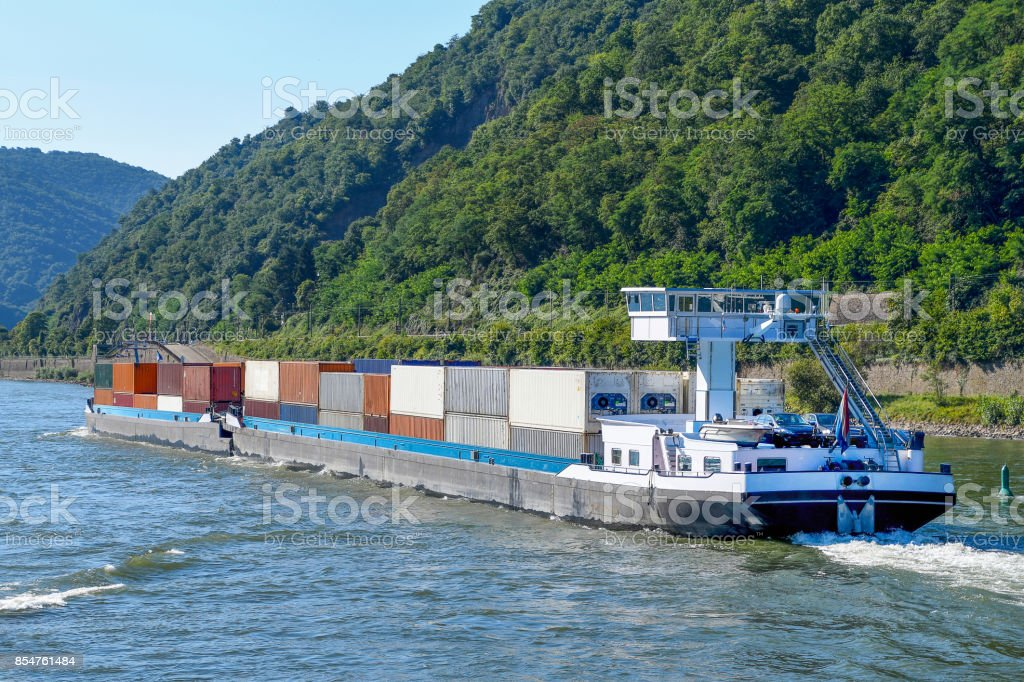 shipping containers on river barge stock photo