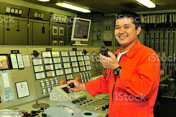 Shipping engineer with orange suit