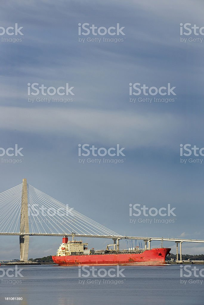Shipping Freighter at Charleston, South Carolina and Cooper River Bridge royalty-free stock photo