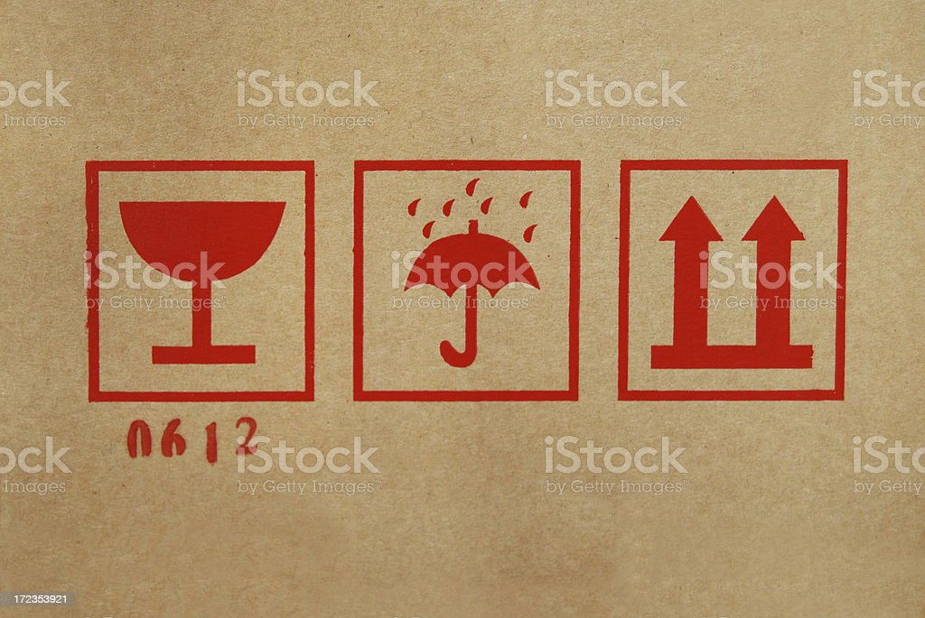 Shipping icons on cardboard box royalty-free stock photo