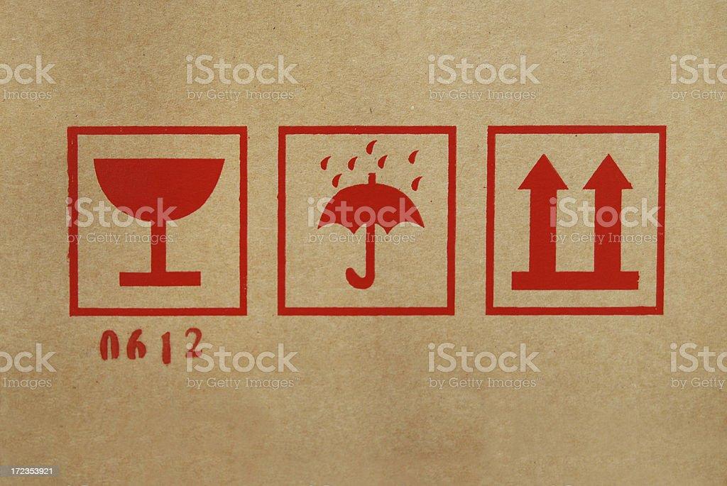 Shipping icons on cardboard box stock photo