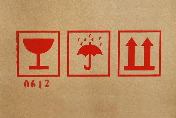 shipping icons on cardboard box - fragile stock pictures, royalty-free photos & images