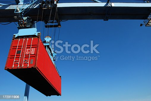 Lifting a container from stack to a ship.Please see similar pictures from my portfolio: