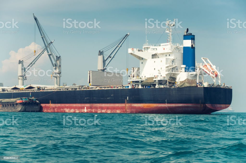 Shipping unloading in the ocean. Business transportation. royalty-free stock photo