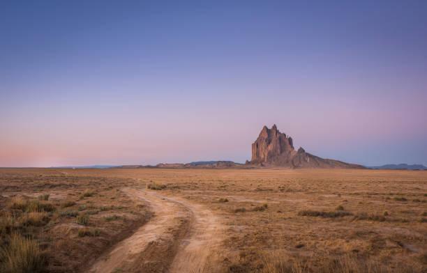 Shiprock at sunrise, New Mexico, USA stock photo