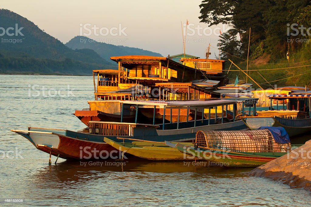 Ships anchored on river bank stock photo