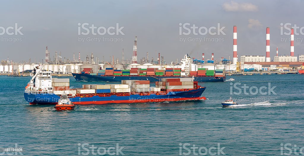 Ships and boats in front of an oil storage terminal stock photo
