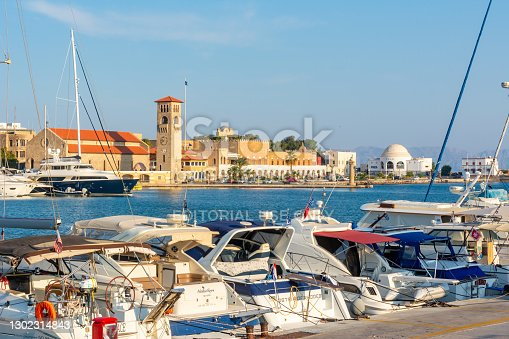 istock Ships and boats in Mandraki harbor, Rhodes, Greece 1302314843