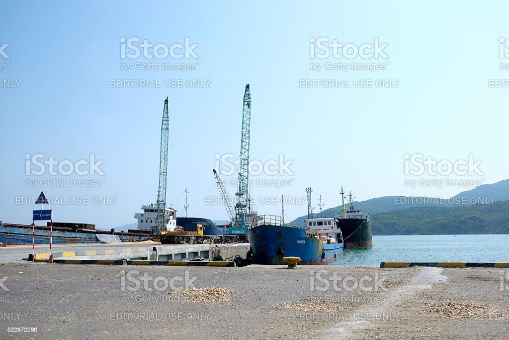 Ships and trucks at Qui Nhon port, Vietnam stock photo