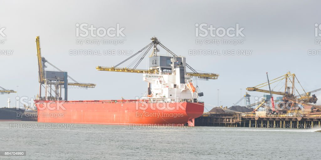 Ships at IJmuiden steel mill of unloading their cargo stock photo