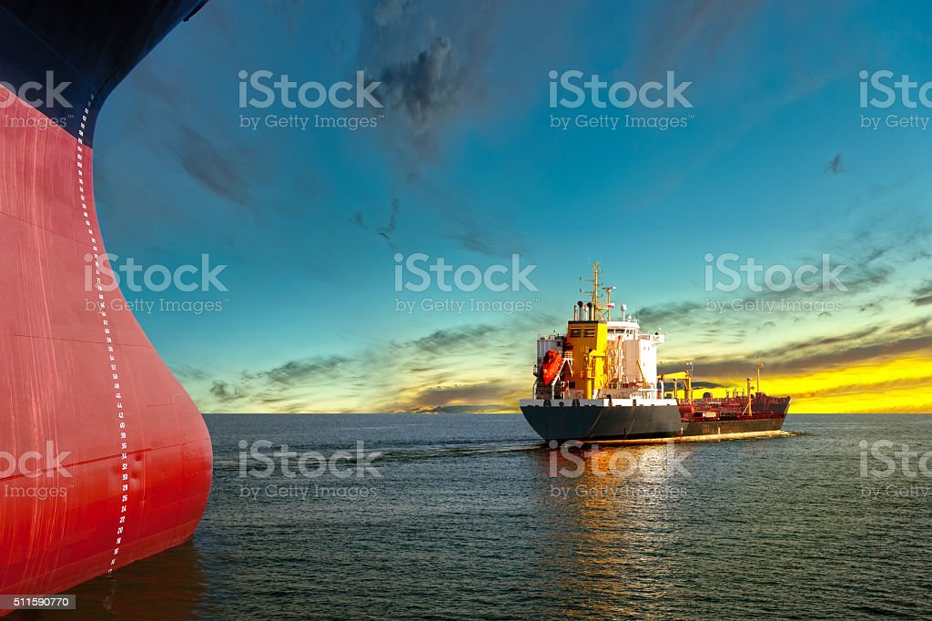 Ships at sunset stock photo