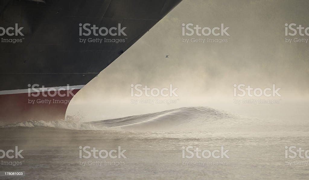 ship's bow creating spray and fumes stock photo