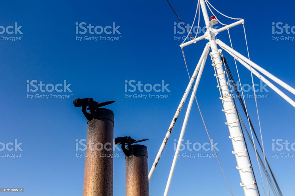 Ship's exhaust pipe with metal cover stock photo