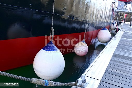 Air filled fenders used to protect the ships hull against damage from the dockside