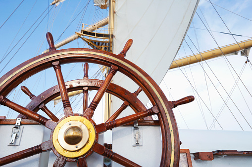 Ships helm on deck of a clipper ship