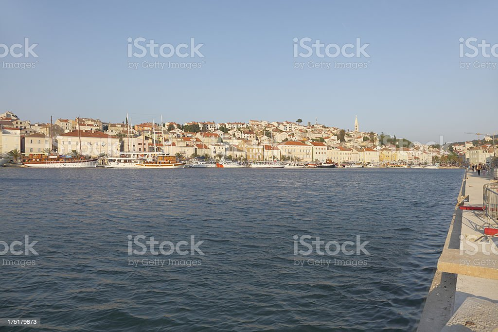 ships in historic Molinji Croatia harbour and town royalty-free stock photo