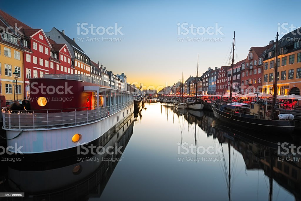 Ships in Nyhaven at sunset, Copenhagen, Denmark stock photo