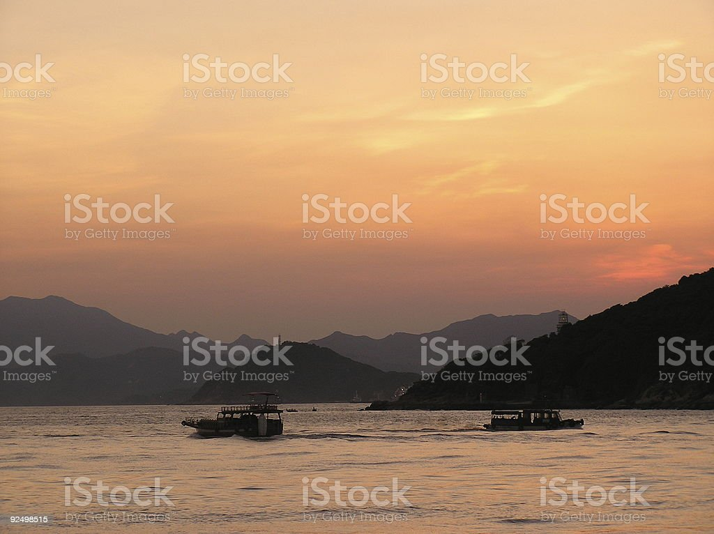 Ships in sunset royalty-free stock photo