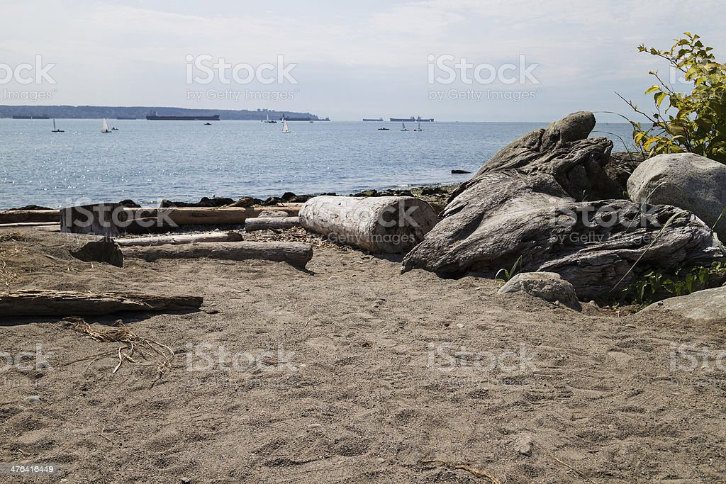 ships on horizon - beach foreground stock photo
