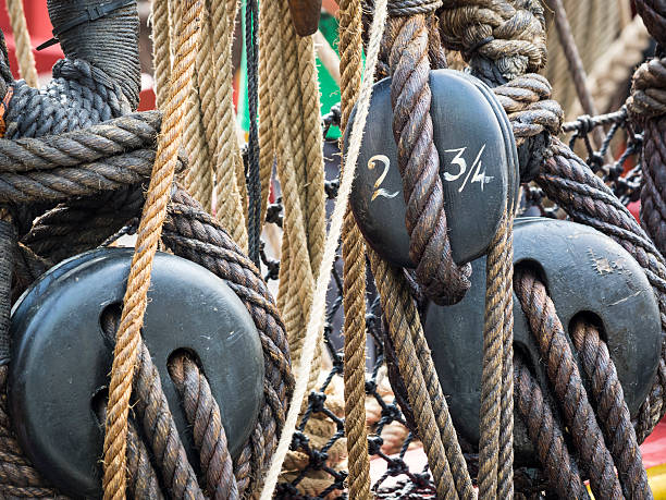 Ship's Ropes and Blocks, 18th century style Ship ropes and blocks for sails from a replica of an 18th c French ship south street seaport stock pictures, royalty-free photos & images