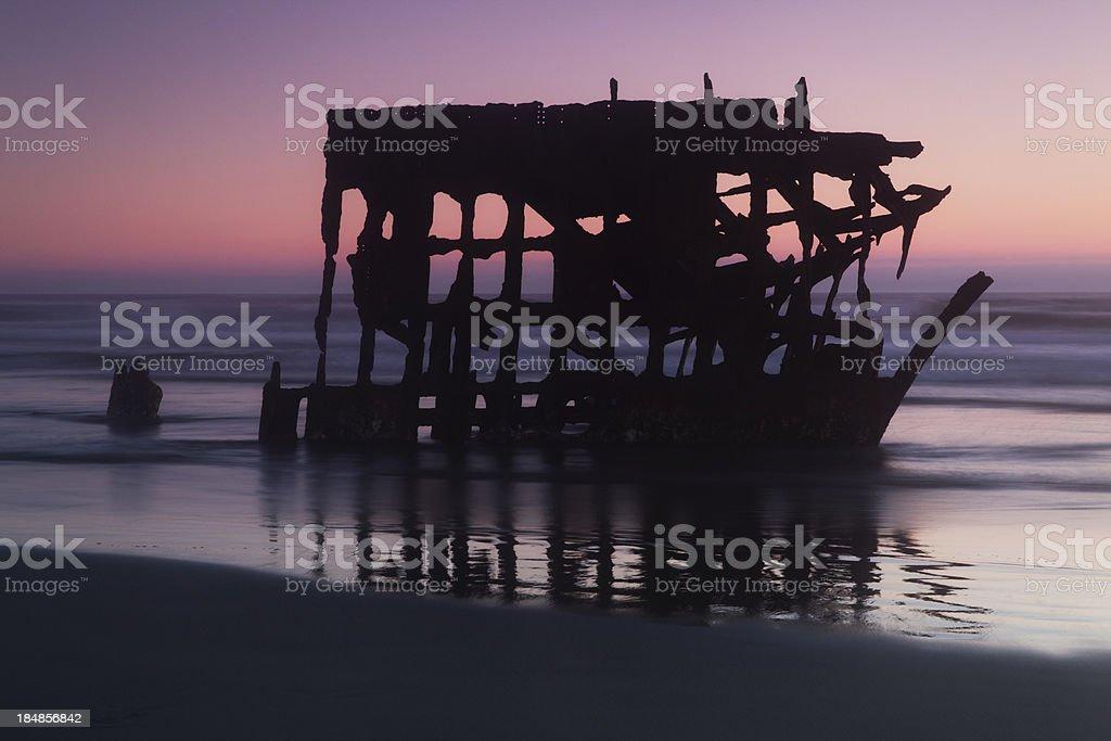 shipwreck at dusk stock photo