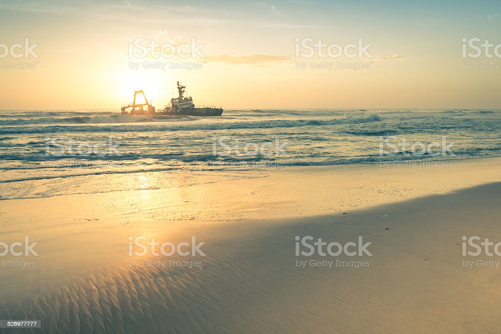 Shipwreck at sunset on namibian Skeleton Coast - Namibia wonders stock photo