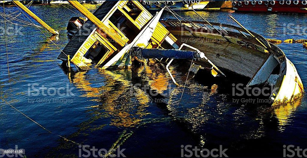 Shipwreck half sunken in Eleusis harbor, Greece stock photo