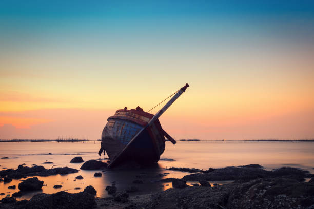 shipwreck in angsila chonburi with sunset - shipwreck stock pictures, royalty-free photos & images