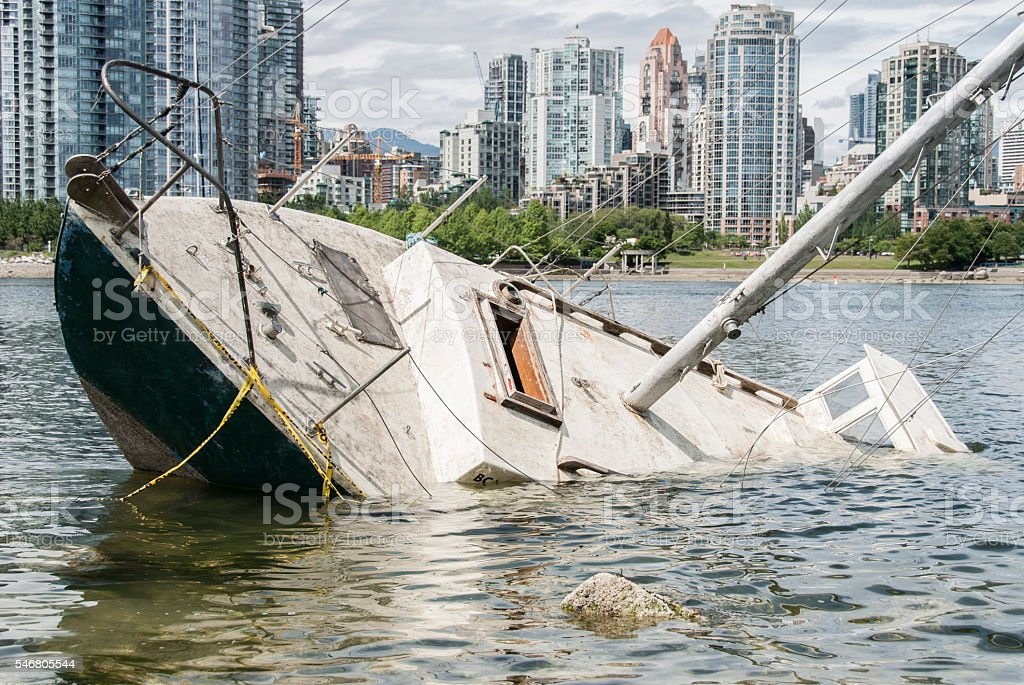 Shipwreck in front of a city stock photo