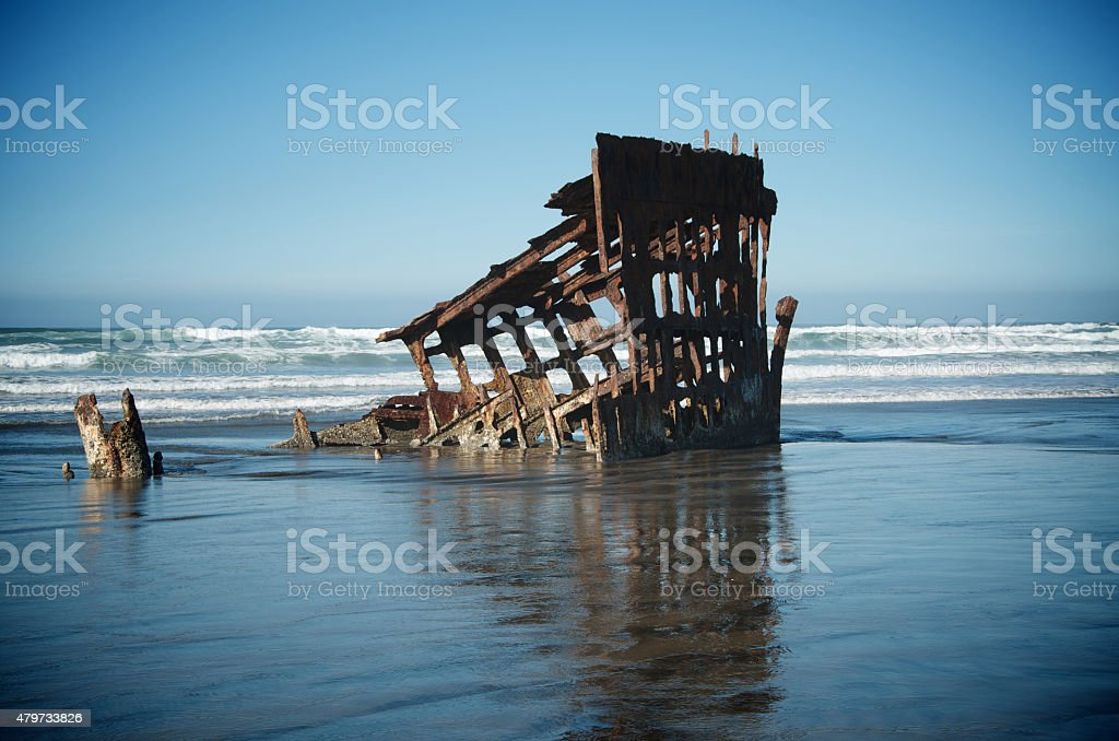 Shipwreck in Ocean Waves stock photo