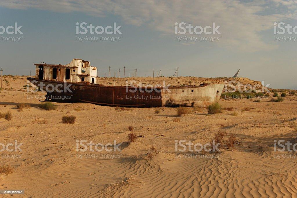 Shipwreck in the desert stock photo