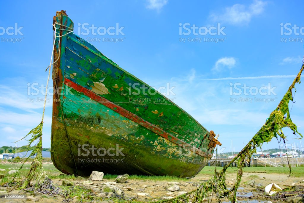 Shipwreck in the port of Paimpol in Brittany, France stock photo