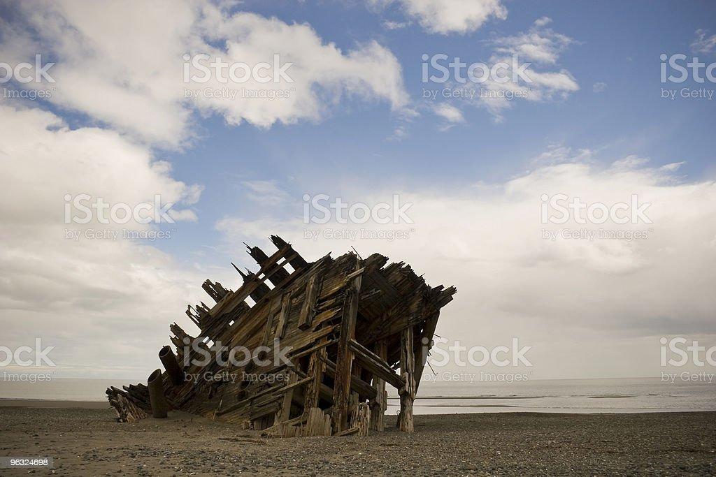 Shipwreck on deserted West Coast ocean beach stock photo