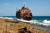 Rusty shipwreck off on the beach of Klein Curaçao - small uninhabited island off the coast of Curaçao, Caribbean