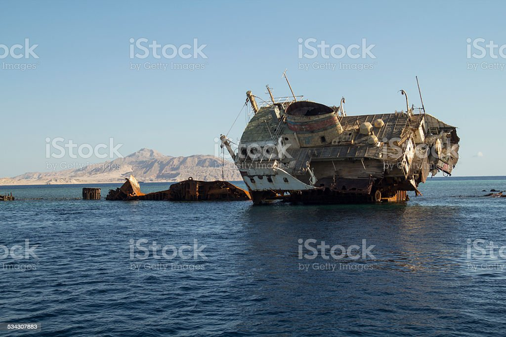 Shipwreck on the reef stock photo