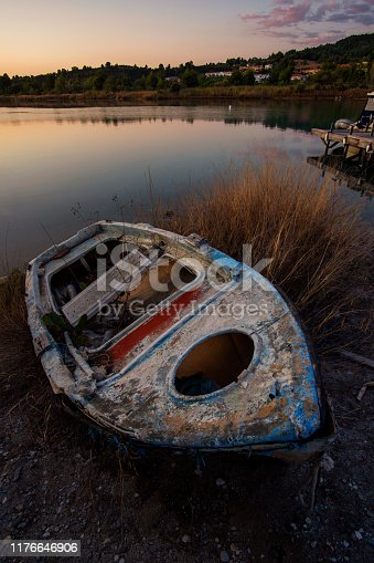 Shipwreck on the shore of a lake