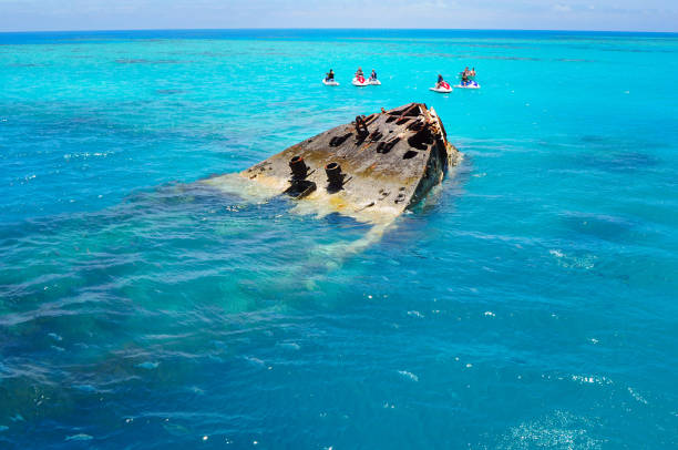 shipwreck partially submerged on bermuda island - shipwreck stock pictures, royalty-free photos & images